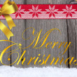 Christmas Greetings on Wooden Board — Stock Photo