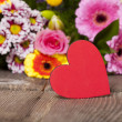 Stock Photo: Red heart in front of Bouquet