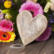 Stock Photo: Flower Greetings with Wooden Heart