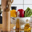 Stock Photo: Cooking Spoon Rack, Vegetable, and Olive Oil on Worktop