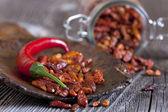 Macro shot of fresh and dried chillies — Stock Photo