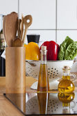 Cooking Spoon Rack, Vegetable, and Olive Oil on Worktop — Stock Photo
