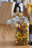 Open Storage Jar with colorful Pasta on Worktop — Stock Photo