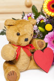 Plush Teddy with red heart — Stock Photo