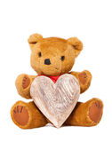 Stuffed animal teddy with a heart of wood — Stockfoto