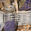 Storage jar dried lavender blossoms — Stock Photo