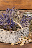 Basket filled with dried lavender bunches — Stock Photo
