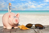 Piggy Bank with banknotes and Sunglasses — Stock Photo