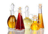 Various Cooking Oils in Glass carafes with real reflection — Stock Photo
