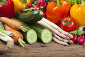 Fresh seasonal vegetables on a wooden table — Stock Photo