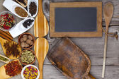 Spices with wooden spoons and chalkboard — Stock Photo