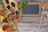 Herbs and spices on rustic wooden background — Stock Photo