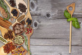 Herbs and spices on old wooden Background — Stock Photo