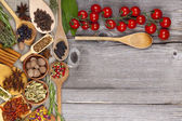 Herbs and spices on wooden background — Stock Photo