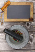 Mortar with pestle and for labeling a slate — Stock Photo
