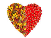 Large heart made of colorful pasta noodles and Tomatoes — Stock Photo