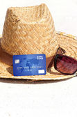 Credit card lying on the beach — Stock Photo