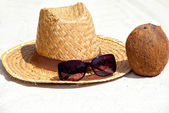 Coconut and Straw Hat on the Beach — Stock Photo