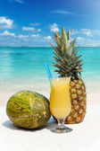 Pineapple, melon and a cocktail — Stock Photo
