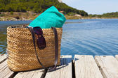 Beach bag with towel at the lake — Stock Photo