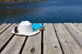 Read a book at the lake — Stock Photo