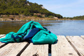 Beach towel lies on a bathing jetty — Stock Photo