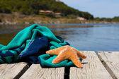 Beach towel with a starfish — Stock Photo