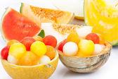 Melon as a bowl for melon balls — Stock Photo