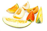 Different varieties of melons in pieces — Stock Photo