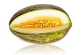 Whole Piel de Sapo melon sliced — Stock Photo