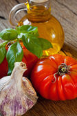 Tomatoes, Basil, Garlic and olive oil — Stock Photo