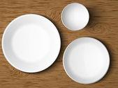 Un conjunto de platos blancos sobre una mesa de madera — Vector de stock