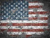 Drapeau américain sur un mur de briques — Vecteur