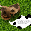 Royalty-Free Stock Vector Image: Cow says on the green grass, with chat to text