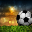 Vettoriale Stock : Football ball on the grass on the stadium with lights, vector illustration