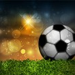 Cтоковый вектор: Football ball on the grass on the stadium with lights, vector illustration