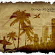 Royalty-Free Stock Vector Image: Grungy old paper with palm trees and the urban surfer