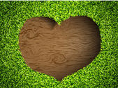 Heart of the grass on a wooden background — Stock Vector