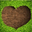 Heart of the grass on a brick background — Stock Vector