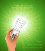 Hand holding energy saving light bulb with rays — Vettoriale Stock