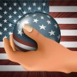 American flag with the ball in his hand — Stock Vector #22447041