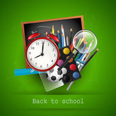 School supplies on blackboard - back to school concept — Stockvector