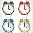 Stock Vector: Set of four vintage alarm clocks