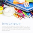 Stock Photo: School supplies on white background
