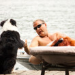 Stock Photo: Dog greets boater