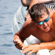 Stock Photo: Summer waterski boat helper