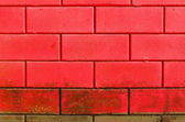 Red dirty brick wall — 图库照片