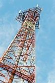 Image of communication pole with blue sky in background — Stock Photo