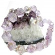 Amethyst geode geological crystals and jewelery beads — Stock Photo