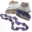 Amethyst geode geological crystals and jewelery beads — Stock Photo #20842093
